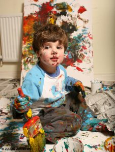 Toddler with paint.